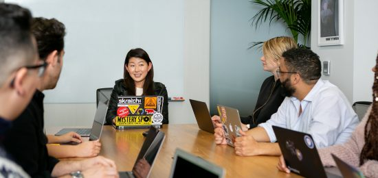 female leader at head of conference table